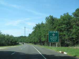 Road sign showing exit for Freehold and Neptune.
